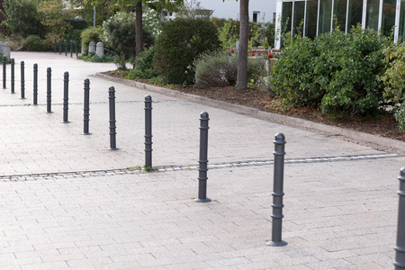 Bollards made of metal on a promenade in a row Stock Photo