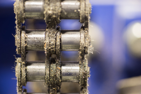 Closeup dirty ratchet gear with chain drive in metal processing