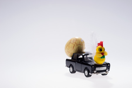 Great Easter egg and little chick on black car Stock Photo