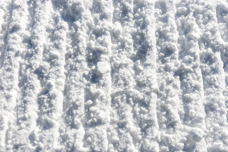 track marks: Snowmobile track marks on the snow, snow background Stock Photo