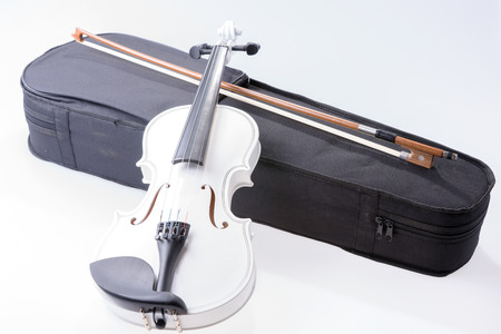 White violin with the bow isolated on white background