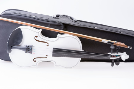 white: White violin with the bow isolated on white background