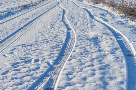 Car tyre trails in the snow