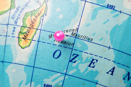 Location Reunion Island. Pink pin on the world globe Stock Photo