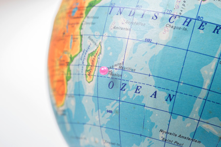 Location Reunion Island. Pink pin on the world globe Stock Photo