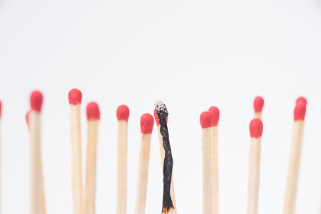 distinctive: Burnt match between new matchsticks, shallow depth of field Stock Photo
