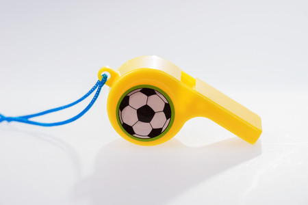 Plastic whistle with cord on white background Stock Photo