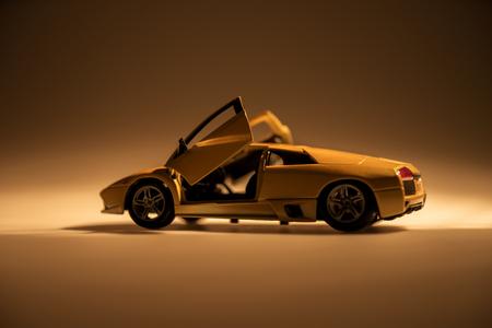 Yellow sports car illuminated with dark background