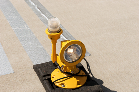 Approach lights of an airfield airport runway Stock Photo