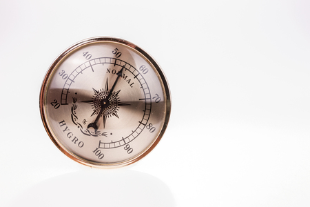 humid: Vintage hygrometer isolated on white background