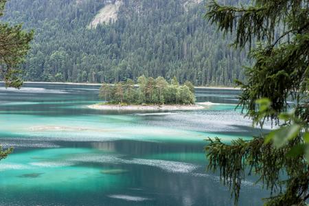 Small idyllic island in the Eibsee near Grainau in Bavaria, Germany