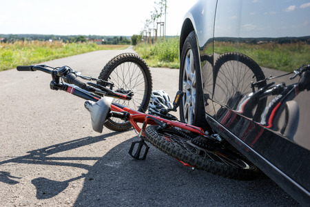 Close Up of a childrens bicycle accident on the street Stock Photo