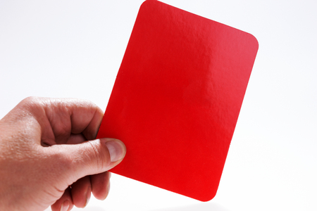 Man holds red card in hand. Isolated on white