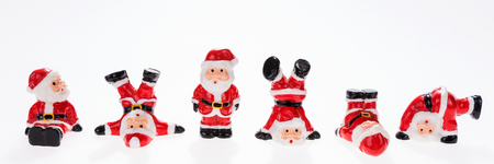 typical: Closeup of six funny Santa Claus figures in a row, panorama image Stock Photo