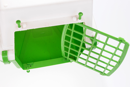 Closeup cat travel plastic cage in green and white