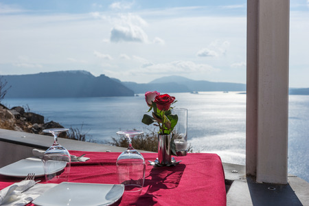 Beautiful restaurant terrace with sea view in Oia Santorini island, Greece Stock Photo