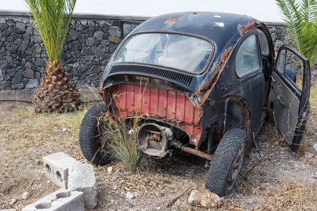 Old rusted german car wreck in the parking