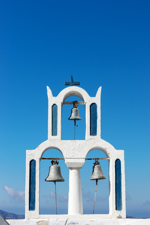 Church with three bells in the town of Fira Santorini