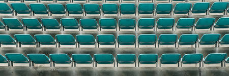 Rows of seats on the stadium. Empty Plastic Chairs at the Stadium