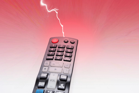 TV DVD remote control isolated on red background