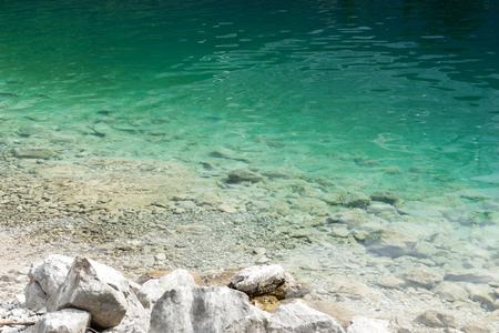Stony shore at the Eibsee in Bavaria, Germany