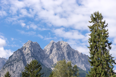 The Zugspitze Germanys highest mountain seen from the village of Grainau in Germany Stock Photo