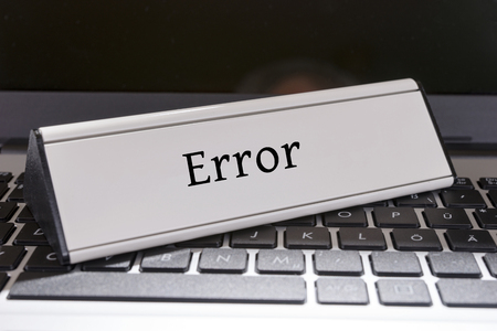 Keyboard and shield with the word Error