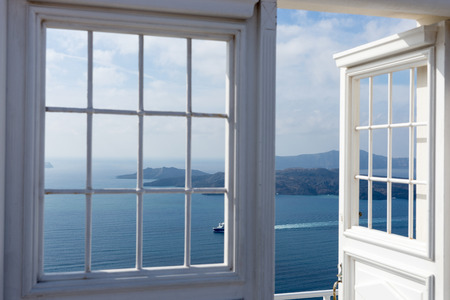 Open door with Mediterranean Sea in Oia, Santorini