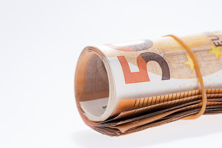A roll of fifty euro banknotes on white background Stock Photo