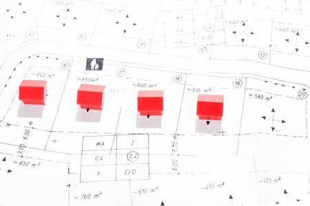 Real estate investment, many houses on ground plan Standard-Bild