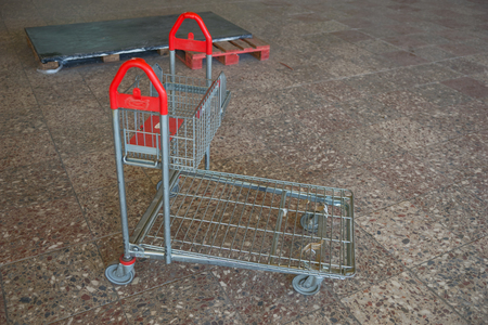 Single empty shopping cart in the abandoned building