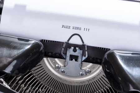 Black text Fake news written on an old retro typewriter Stock Photo - 94809671