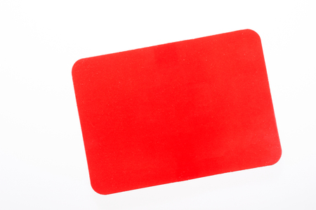 Red card isolated on white for sport concept