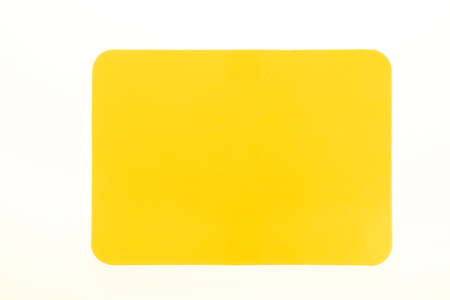 Yellow card isolated on white for sport concept