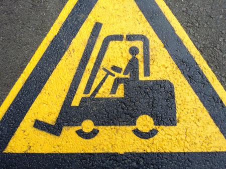 Forklift truck sign on the black asphalt