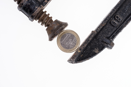 One euro coin in a black clamp isolated on white background Stock Photo