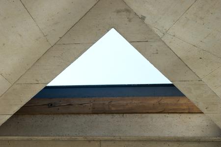 Empty triangle window in the modern interior Archivio Fotografico