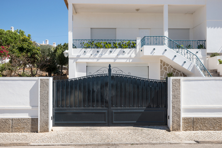 New dark metal double gates for entry into the yard Foto de archivo