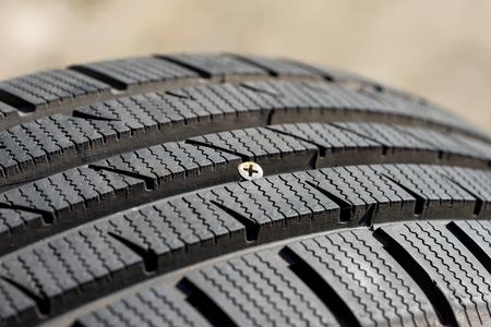 metal screw in damaged tire before repair