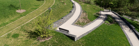 Empty barrier-free path in the landscape garden 写真素材