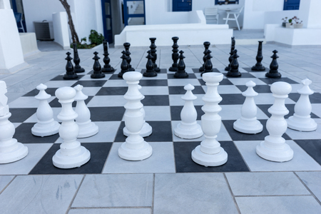 Large chess pieces on the outdoor terrace. Outdoor chess game