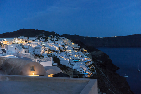 Lights of the city of Oia at night on the island of Santorini Stock Photo