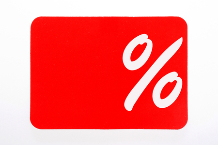 White percent sign on red background. Sale concept Stock Photo