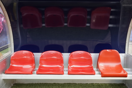 Detail of red reserve chair and staff in sport stadium Stock Photo