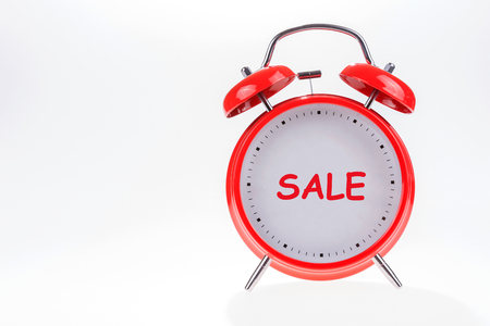 Old red retro alarm clock with text sale 写真素材