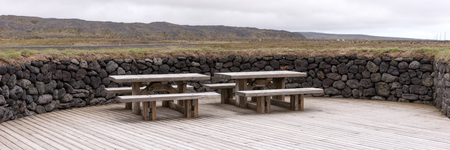 Rest area with benches and wooden tables in the park