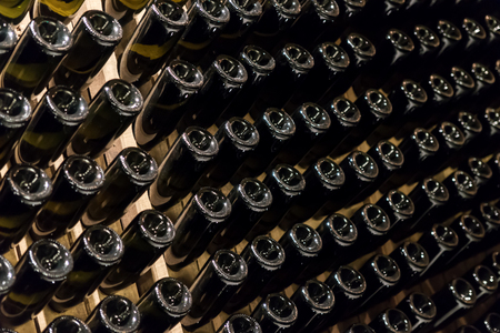 Many wine or champagne bottles are stored in the wine cellar