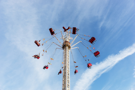 People ride high in the air at a carnival festival