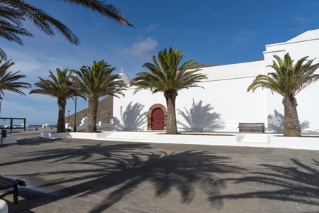 White church and palm trees at Femes in Lanzarote. Canary Islands. spain Stock fotó
