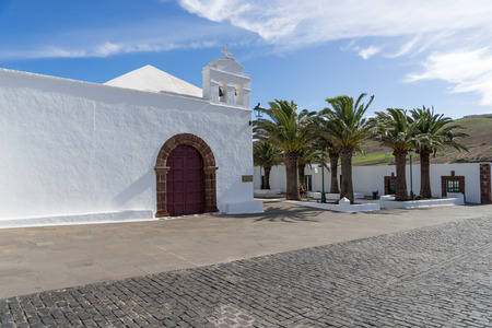 White church and palm trees at Femes in Lanzarote. Canary Islands. spain